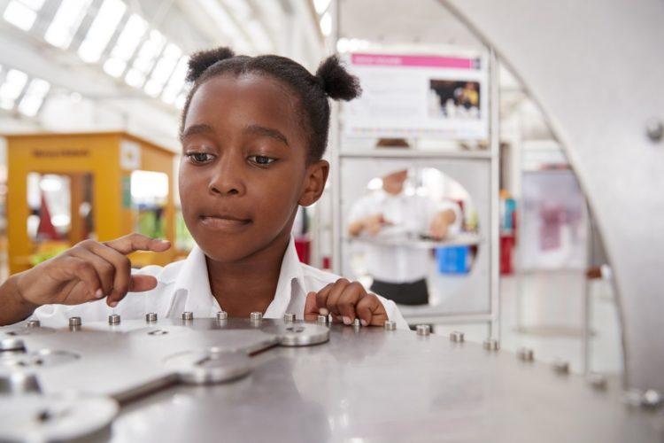 Smart schoolgirl doing a science experiment test