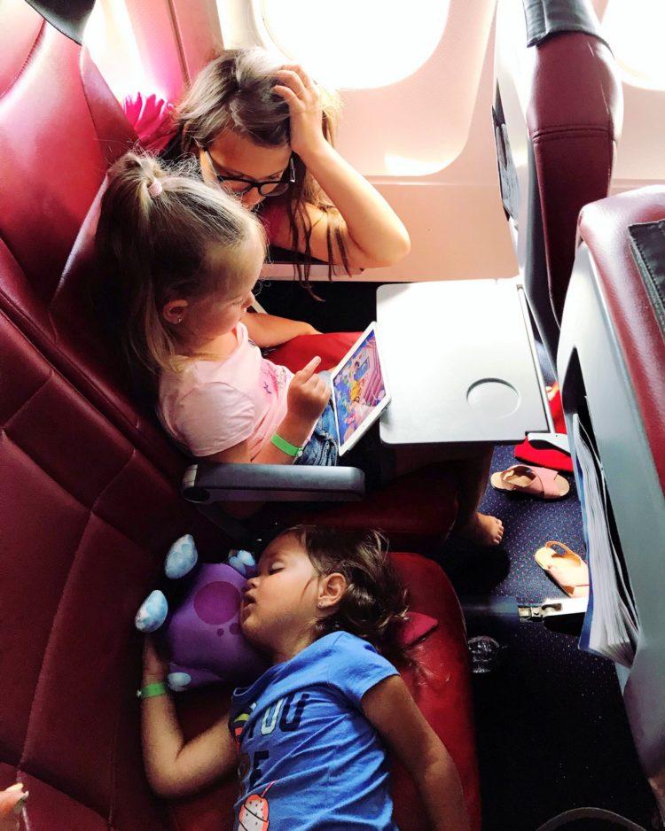 Kids sleeping on a long airplane flight