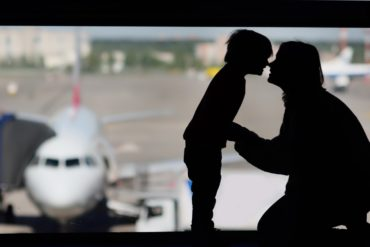 Mother and child in an airport