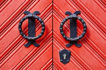 Antique metal door knockers on a door