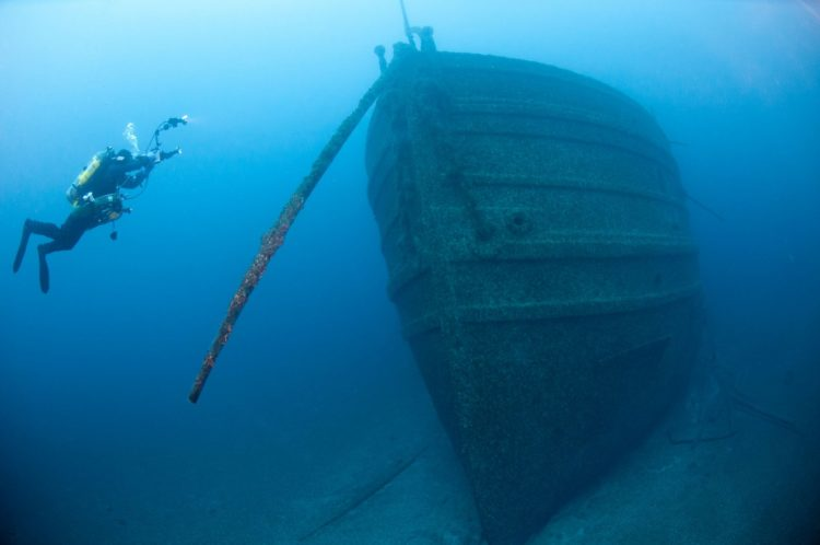 A diver explores a shipwreck at the Thunder Bay sanctuary (NOAA-NMS)