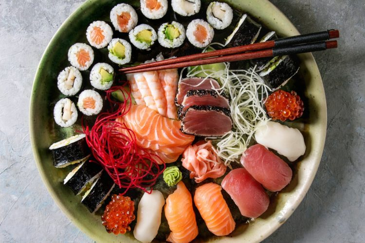Large plate of sushi and rolls