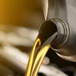 Pouring fresh motor oil