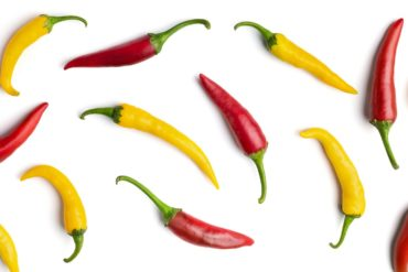 Red and yellow hot peppers abstract background