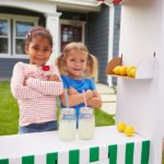 Two girls with a cute lemonade stand