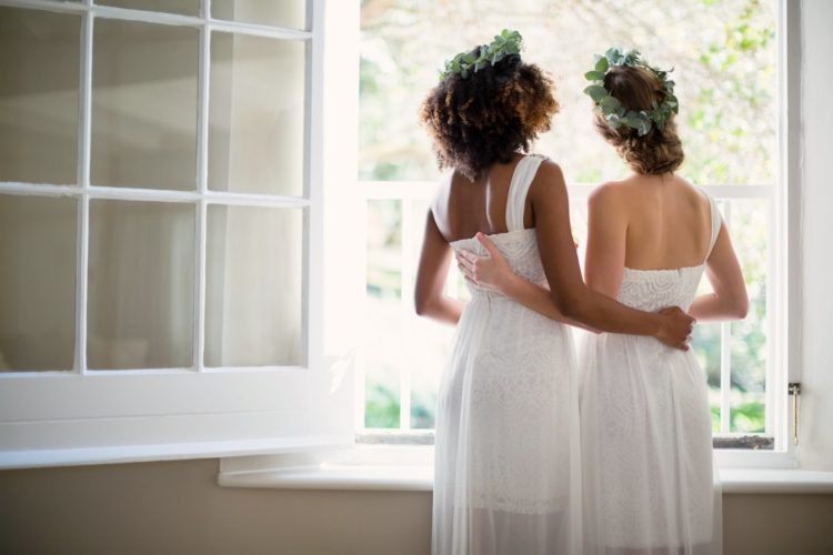 Two brides in inexpensive wedding dresses