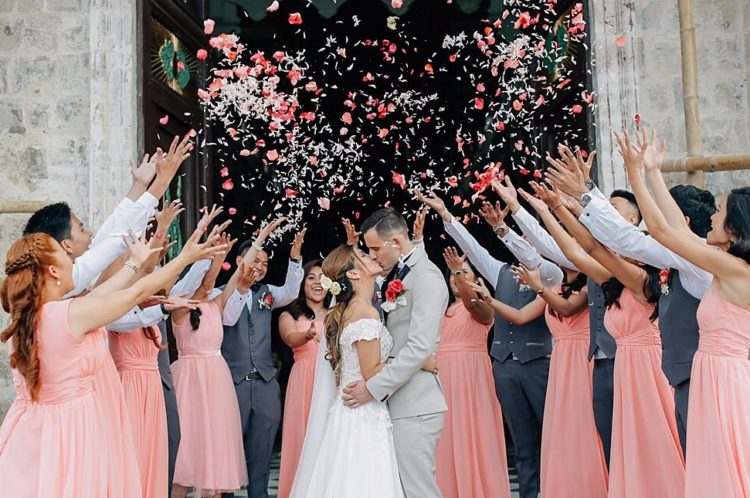 Wedding confetti and celebration with budget bridal gown