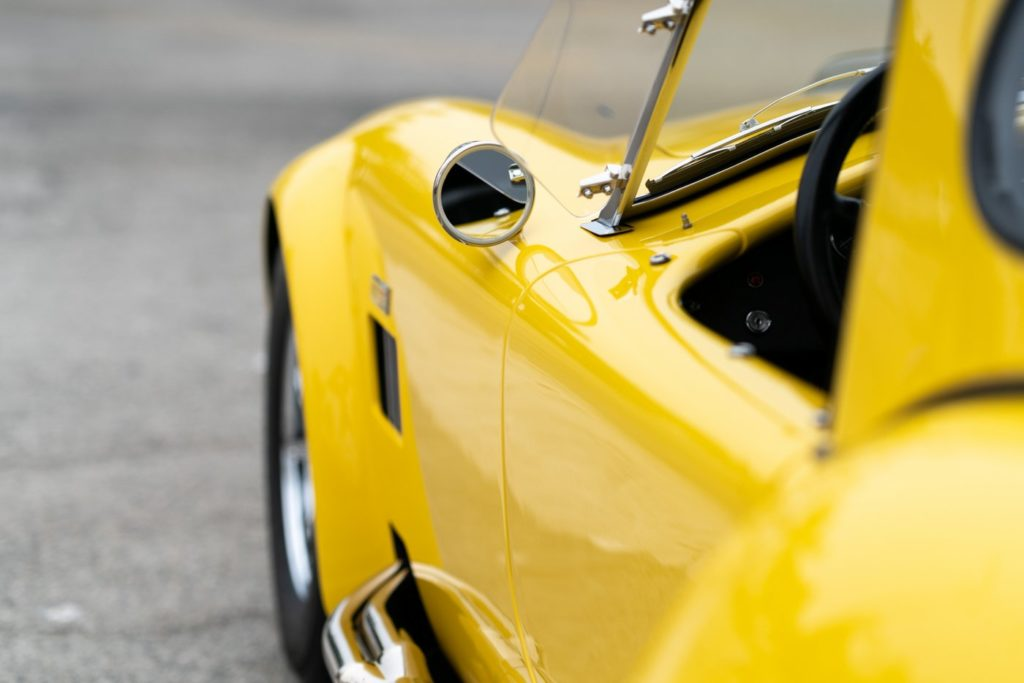 Shiny yellow waxed vintage sports car