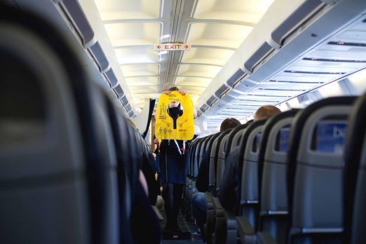 Airplane flight attendant safety demonstration