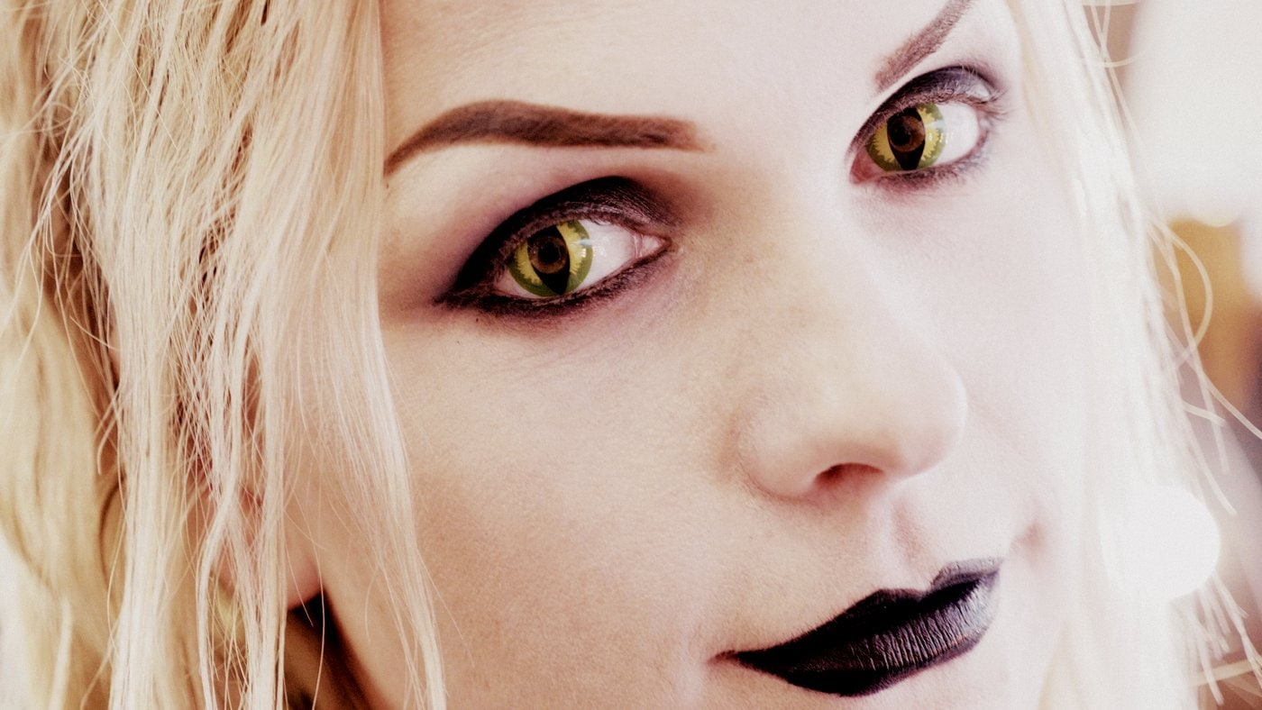 Woman with cat eye Halloween contact lenses