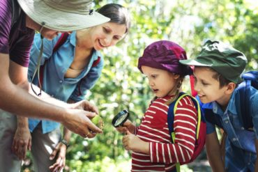 Family hiking and learning science nature